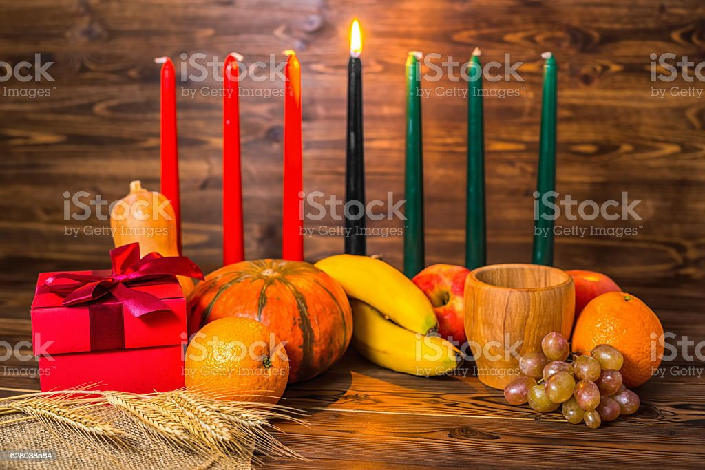 african Kwanzaa festive concept with decorative candles red - Photo