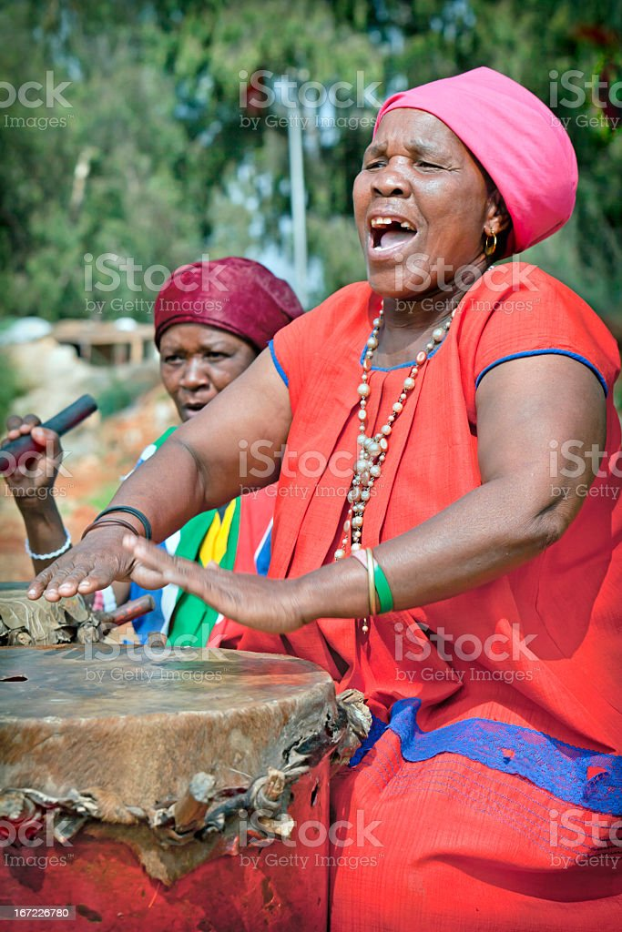 African Lady Playing the Drums stock photo