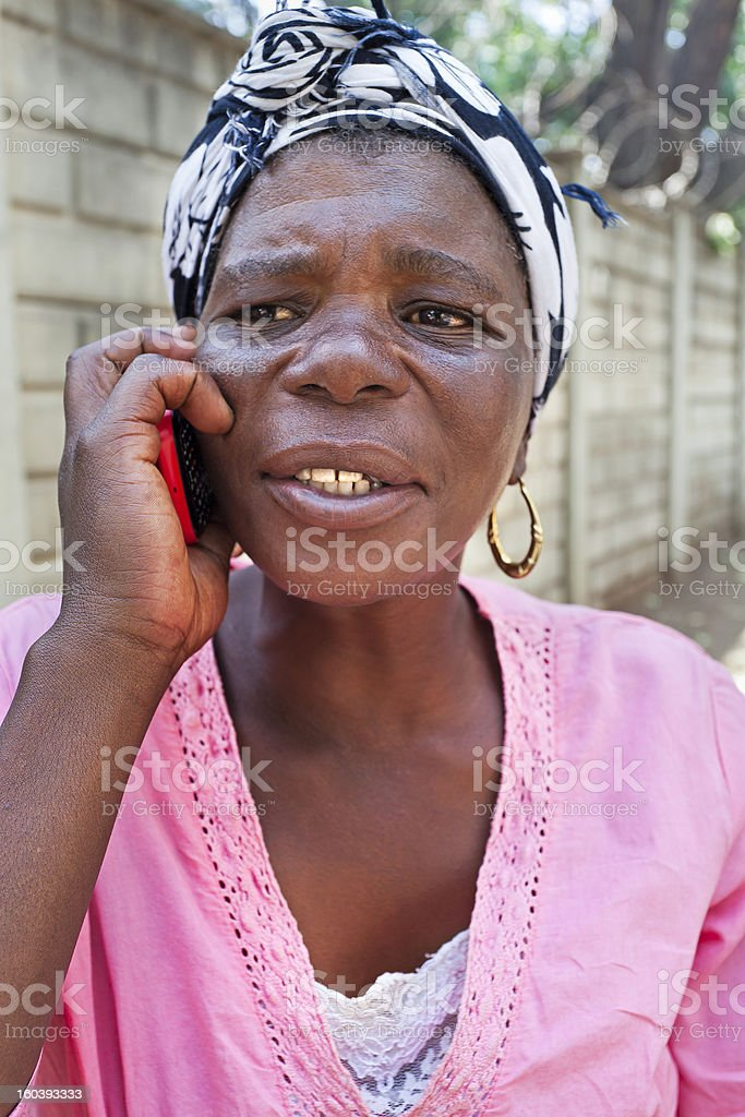 African Lady talking on the mobile stock photo