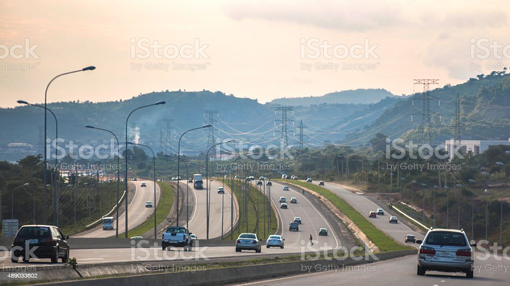 African landscape and highway traffic. Abuja, Nigeria. stock photo
