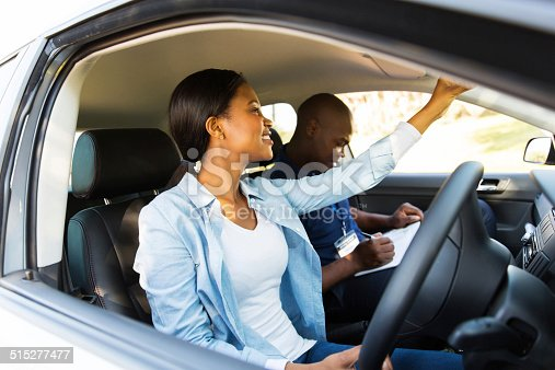 istock african learner driver adjusting rear view mirror 515277477