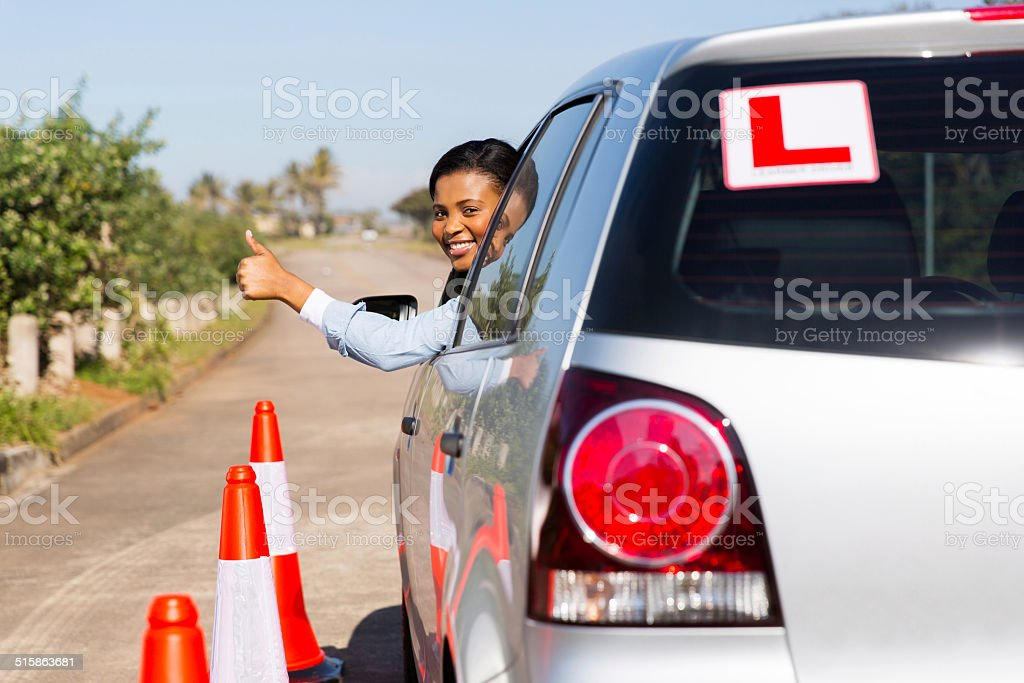 african learner driver looking out of the car window stock photo