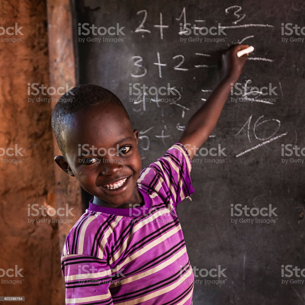 African little boy during math class, southern Ethiopia, East Africa stock photo