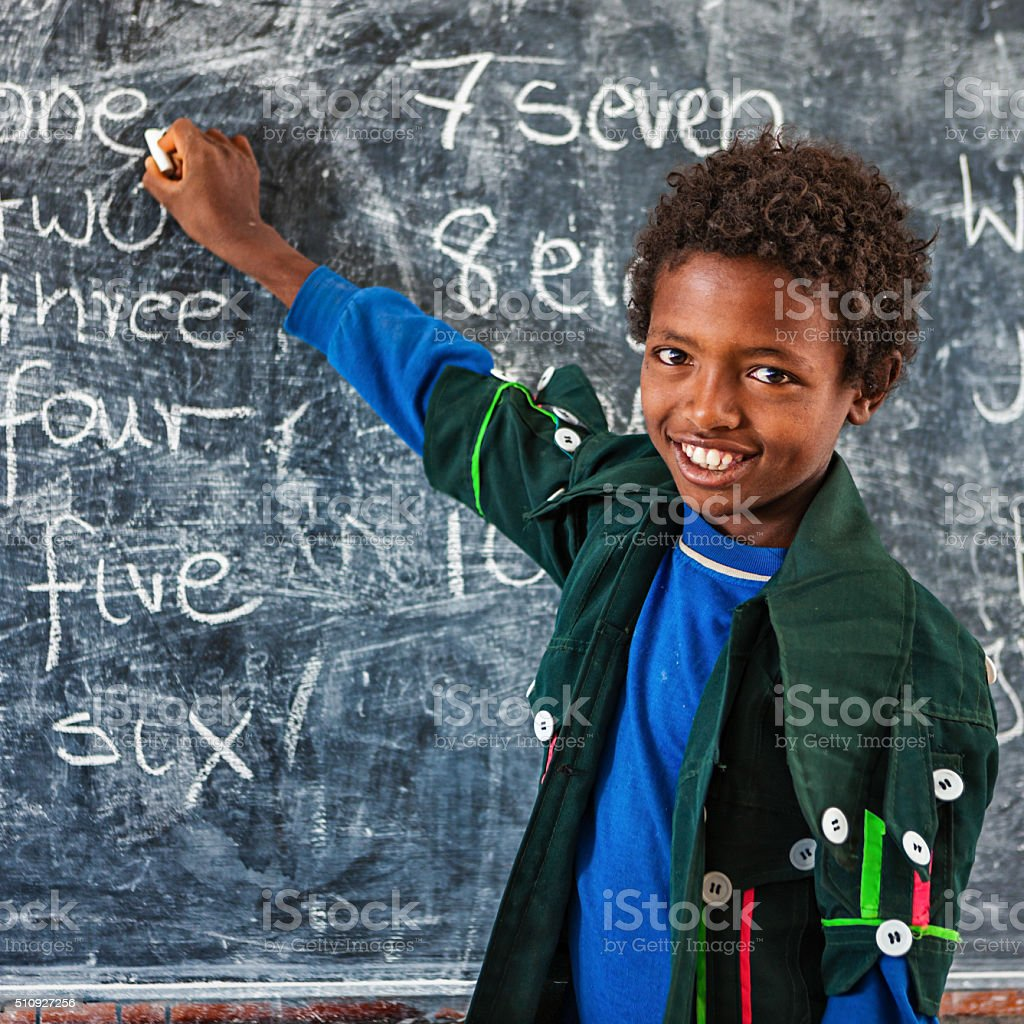 African little boy is learning English language stock photo