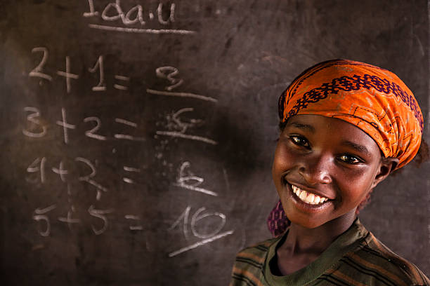 African little girl during math class, southern Ethiopia, East Africa stock photo