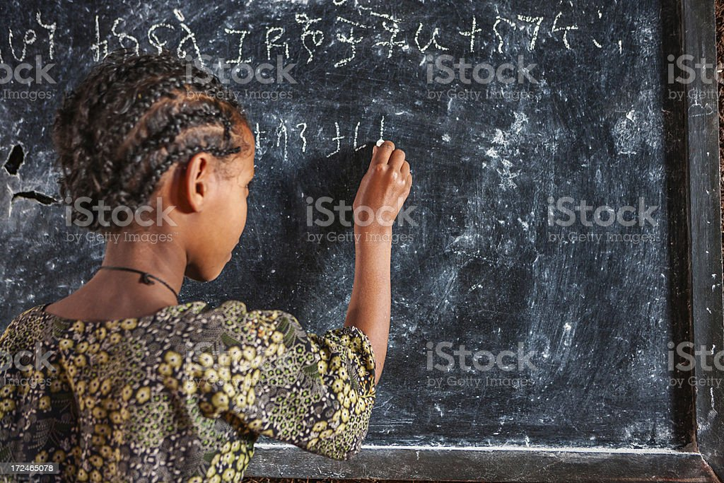 African little girl is learning Amharic language royalty-free stock photo