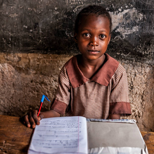 African little girl is learning English language, orphanage in Kenya stock photo