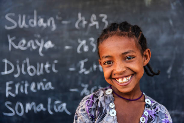 african little girl is learning  english language - horn of africa stock photos and pictures