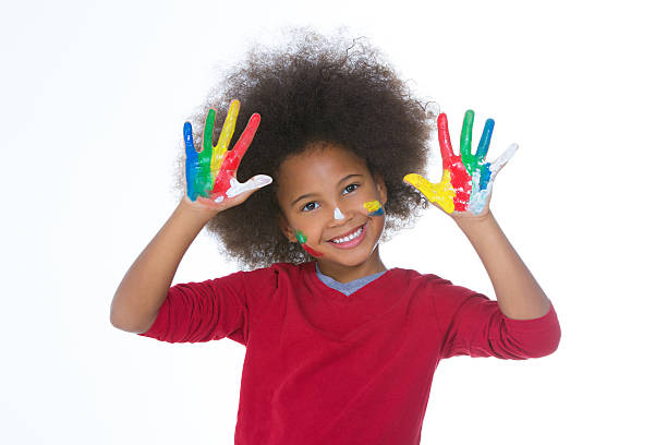 african little girl painting stock photo