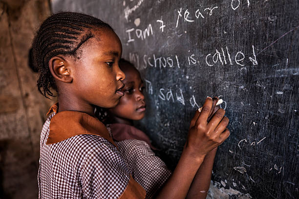 African little girls are learning English language, orphanage in Kenya stock photo