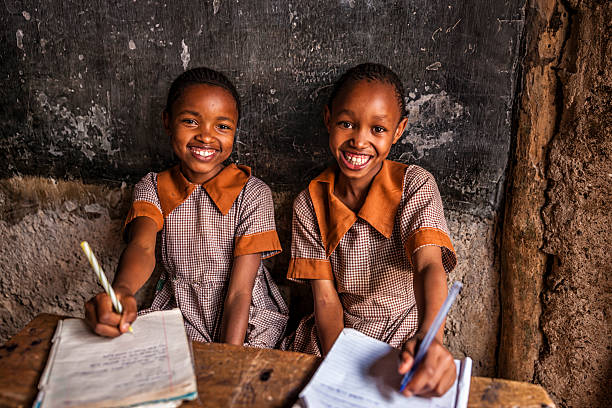 african little girls are learning english language, orphanage in kenya - kenya stock photos and pictures