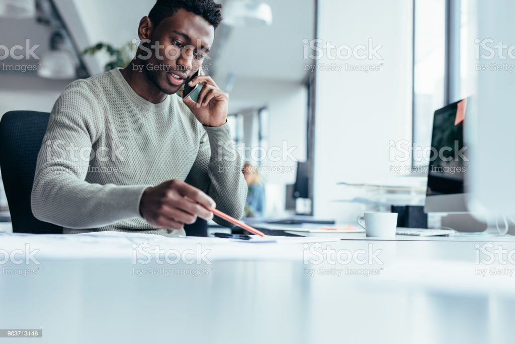 African male architect working in office stock photo