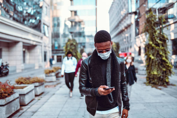 African Male Demonstrating Against Air Pollution With Mask stock photo