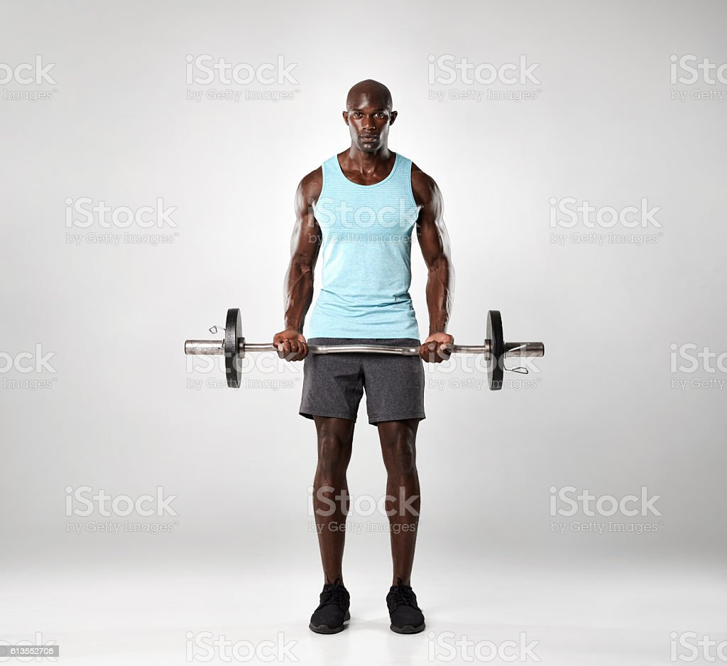 African male exercising with barbell stock photo