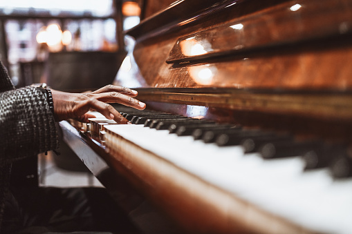 African Male Gently Playing The Piano