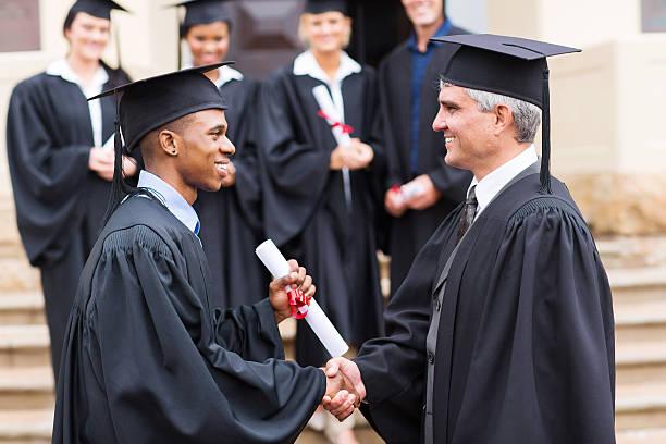 African male graduate handshaking with dean picture id475846573?b=1&k=6&m=475846573&s=612x612&w=0&h=qgtcnubu wh6z1cc ahbtdjxc5j5cxnnjya7k0 n04a=