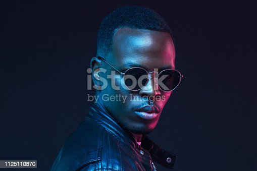1095939686istockphoto African male model portrait, wearing trendy sunglasses and leather jacket 1125110870