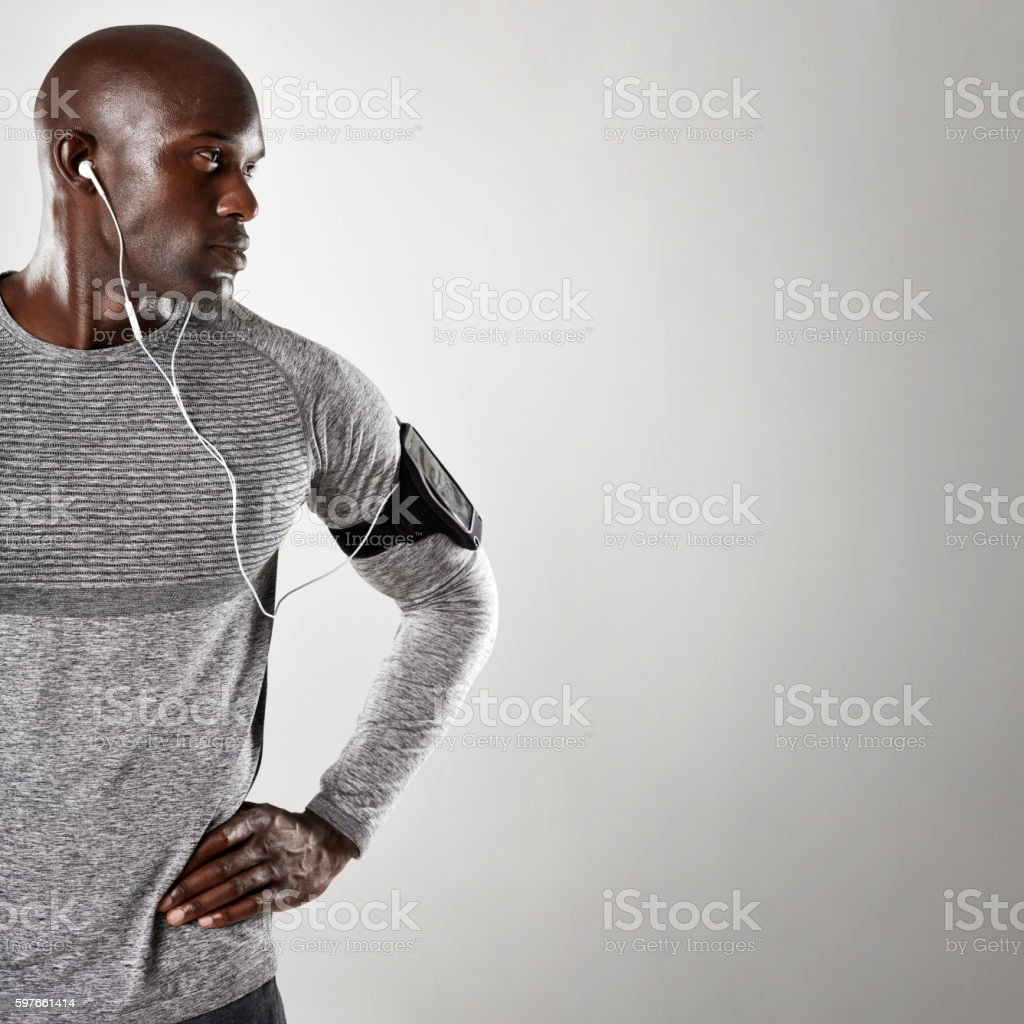 African male model with earphone looking at copy space stock photo