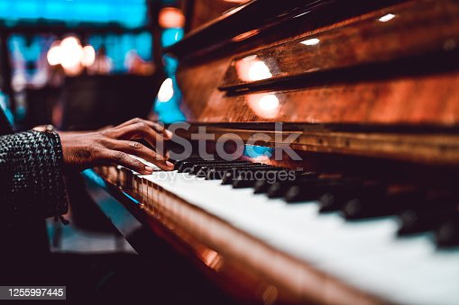 African Male Playing Beautiful Song On Piano