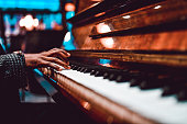istock African Male Playing Beautiful Song On Piano 1255997445