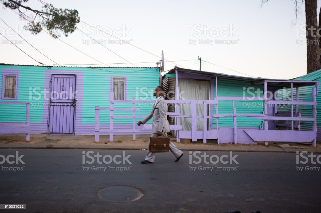 African male walking with confidence stock photo