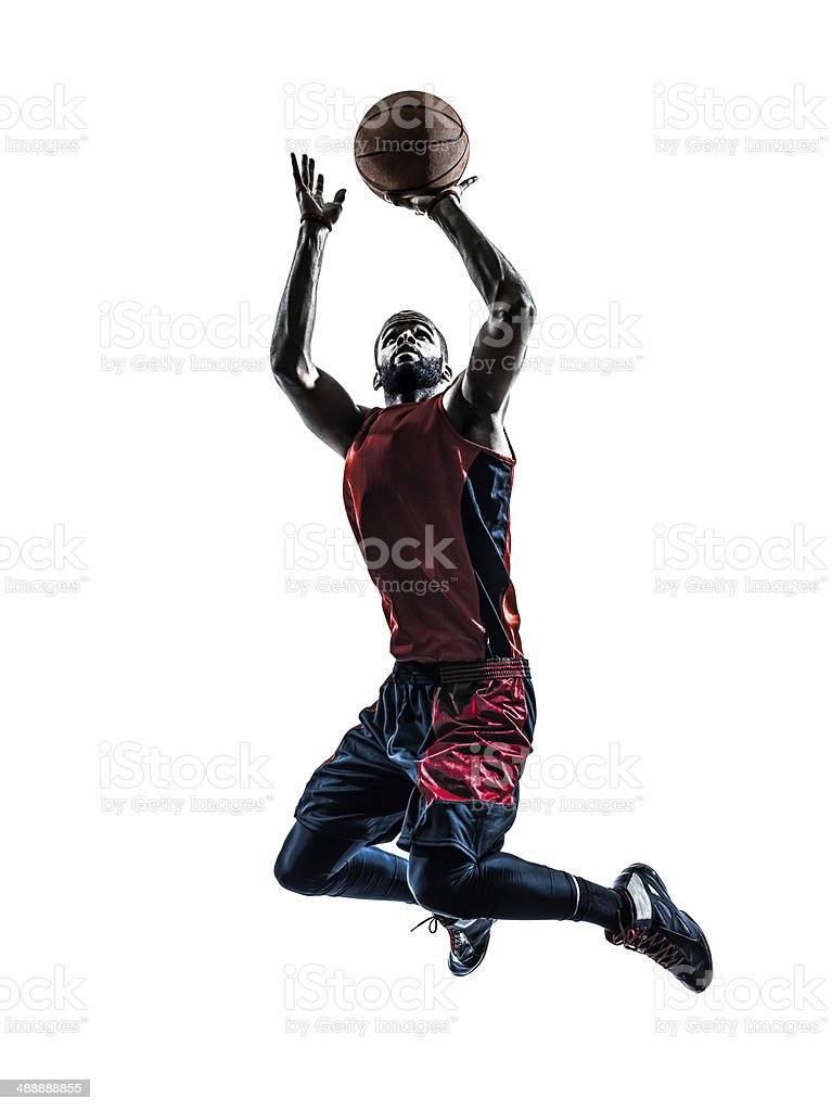 african man basketball player jumping throwing silhouette stok fotoğrafı