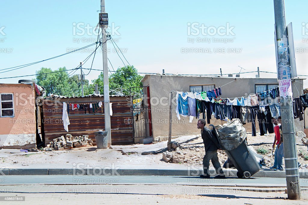 African man carting his goods to recycle stock photo