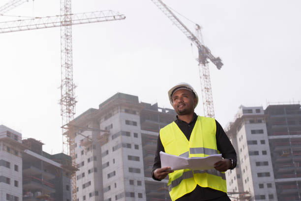 african man civil engineer working at a construction site. - civil engineer stock photos and pictures