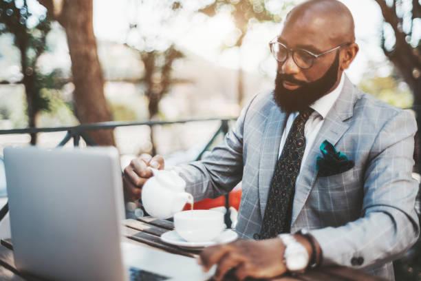 African man entrepreneur with laptop stock photo