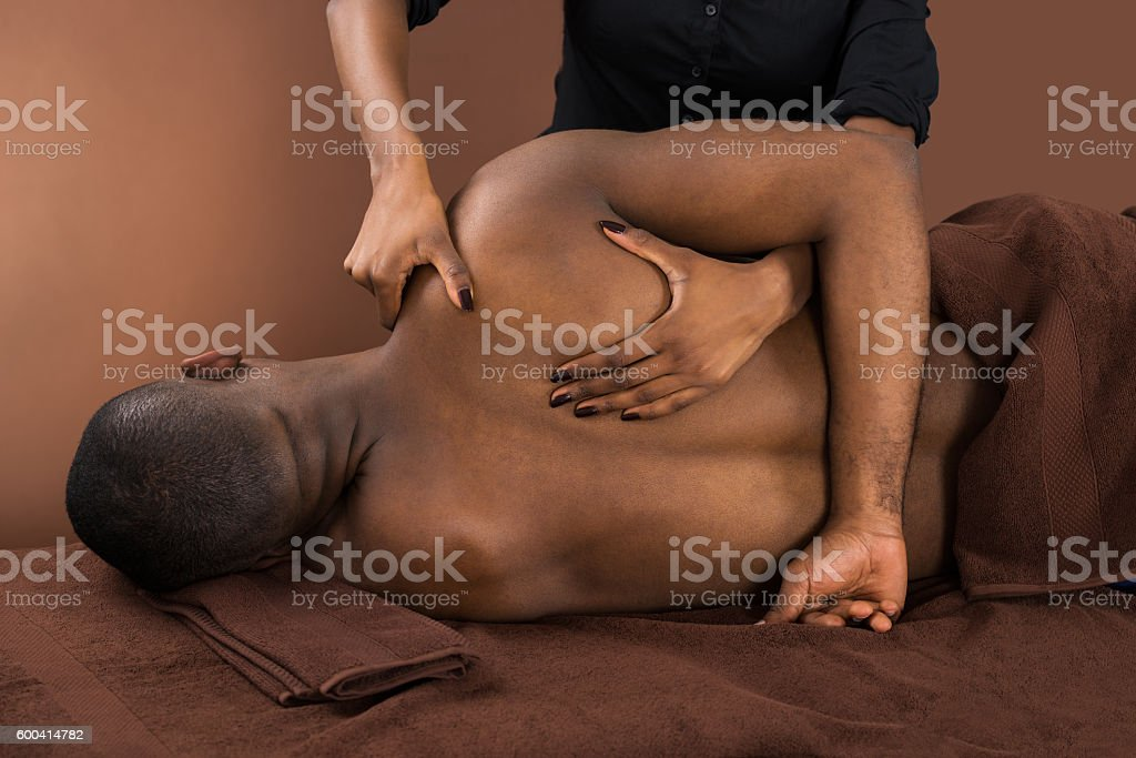 African Man Getting Spa Treatment stock photo