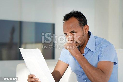 istock African man got a bad letter uvolnenii 1153396396