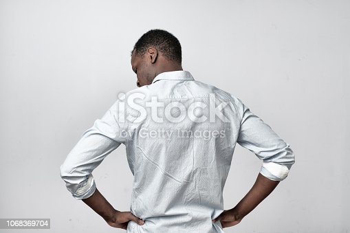611876426 istock photo African man in white shirt turning back 1068369704