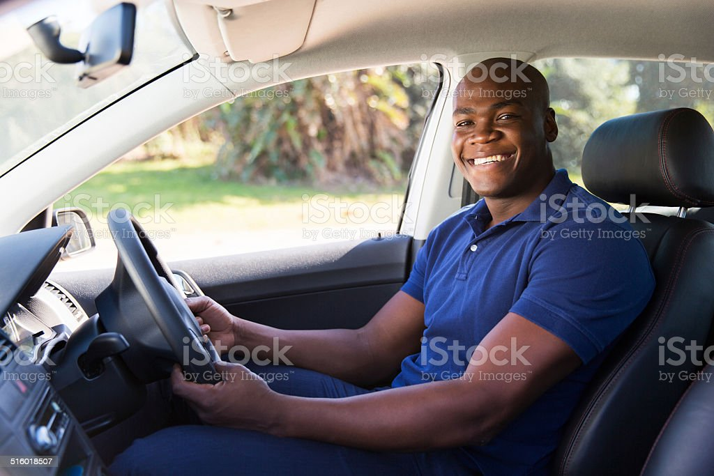 african man inside his new car stock photo