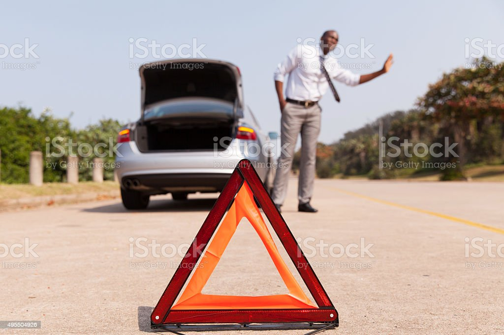 african man looking for help after a car breakdown stock photo