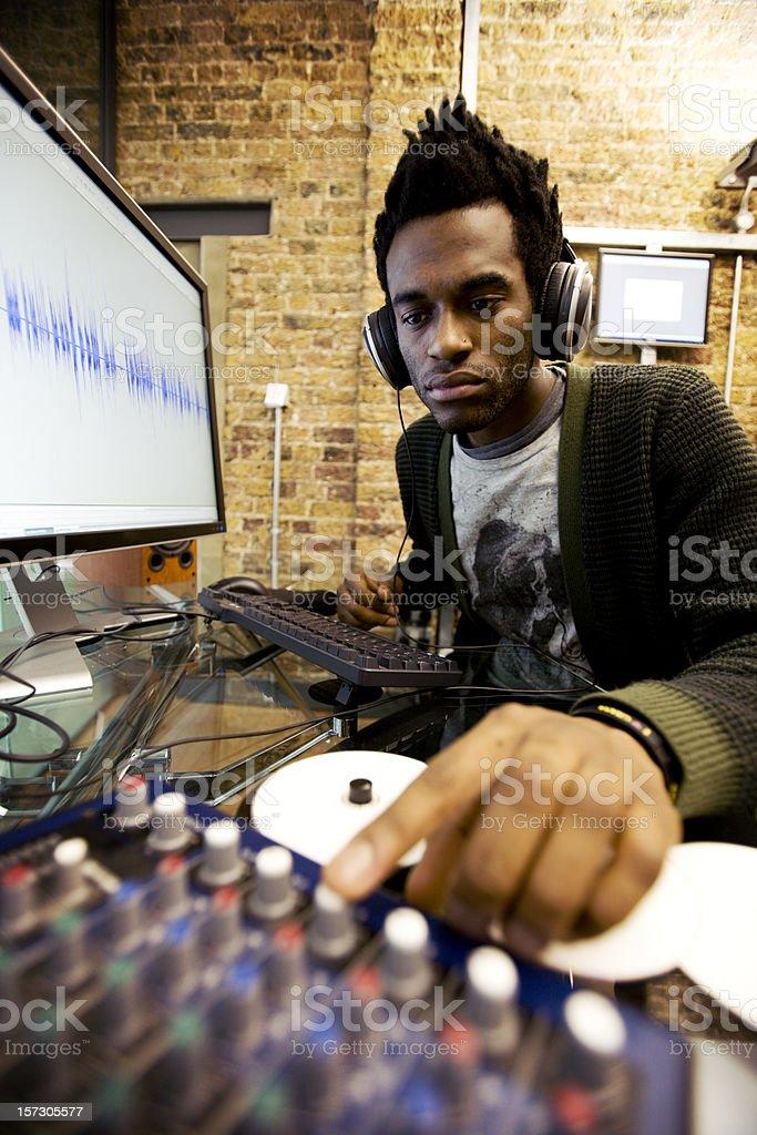 African man mixing audio at computer stock photo