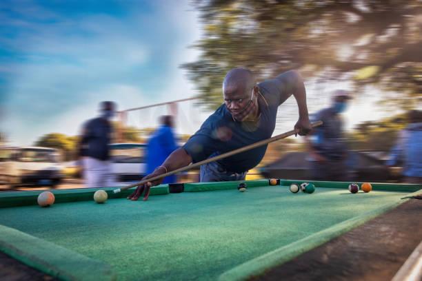 African man playing snooker