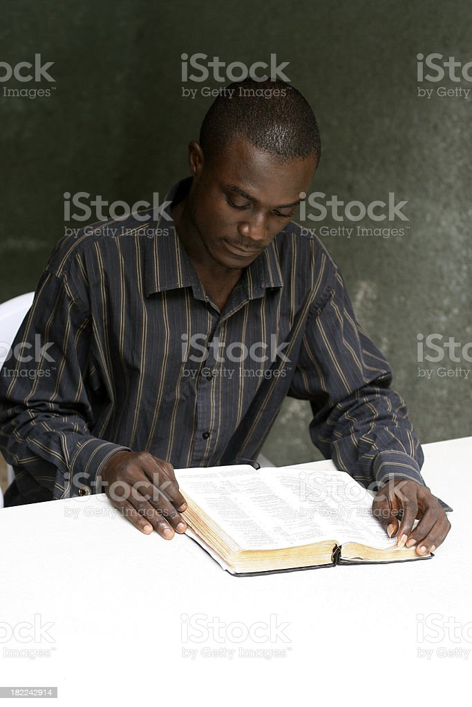 African Man Reading Bible stock photo