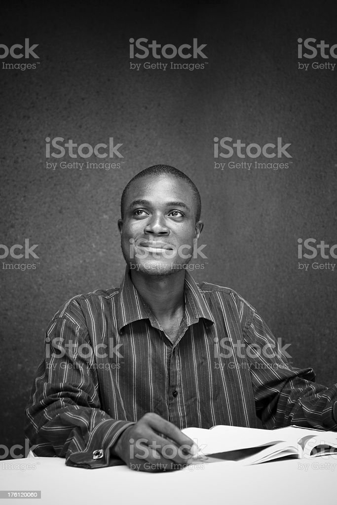 African man reading royalty-free stock photo