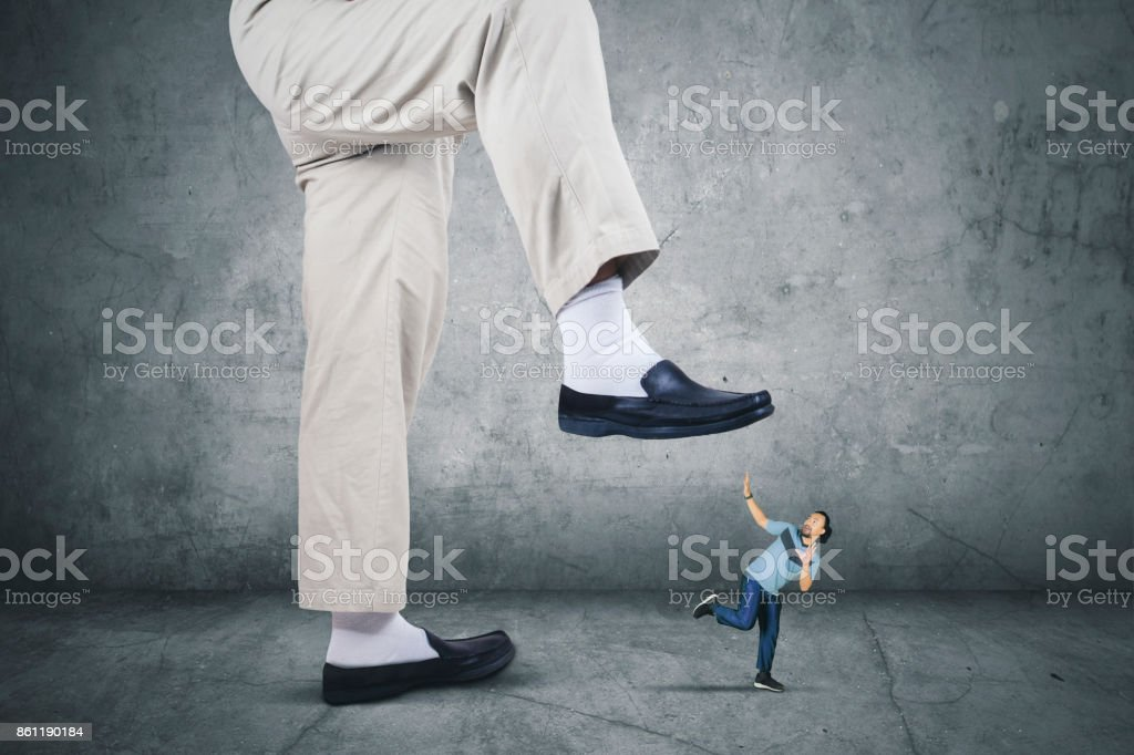 African man running from his boss foot stock photo