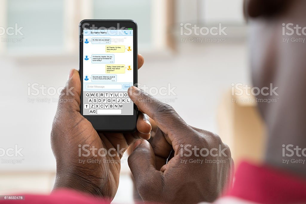 African Man Sending Message stock photo