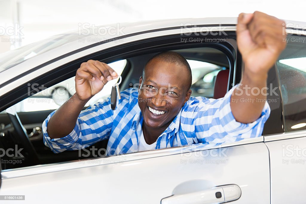 african man showing a car key stock photo