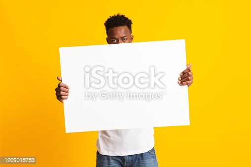1159989540 istock photo African man showing blank white big A2 paper 1209015753