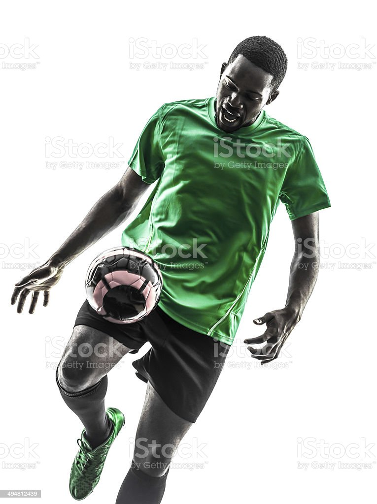 african man soccer player juggling silhouette stock photo