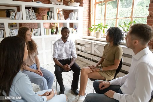 511741068 istock photo African man speaking during group counseling therapy session 1139791188