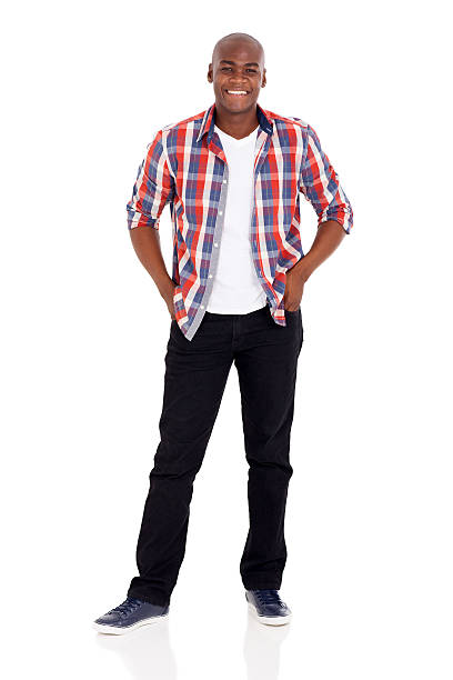 african man standing happy african man standing on white background plaid shirt stock pictures, royalty-free photos & images