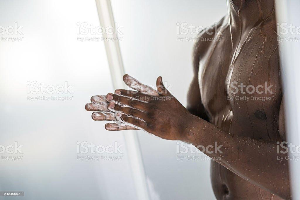 African Man Taking Shower stock photo