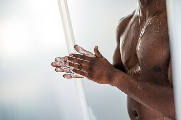 African Man Taking Shower stock photo