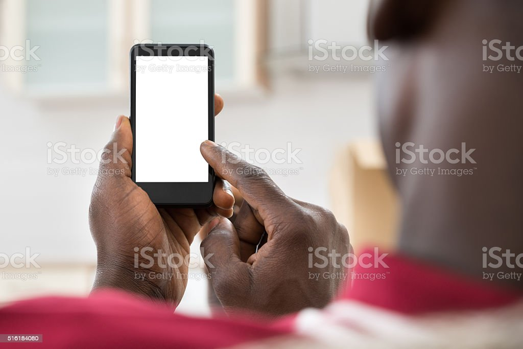 African Man Using Cellphone stock photo