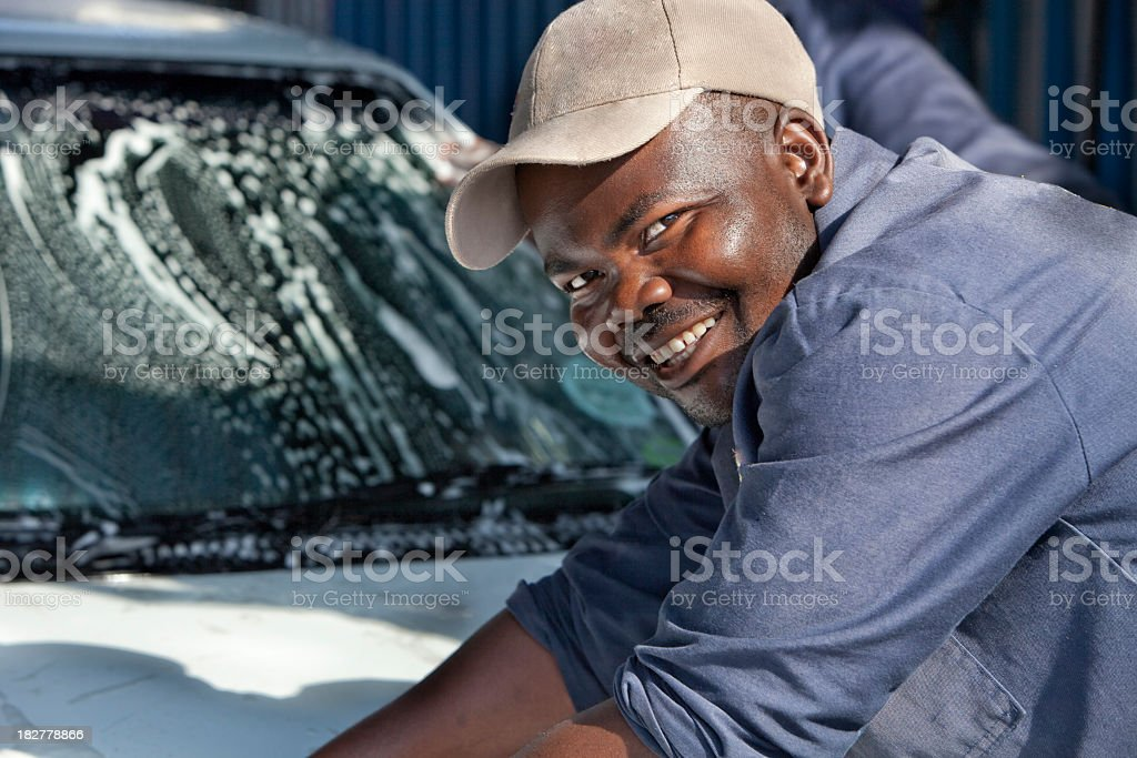 African Man Washing a Vehicle stock photo