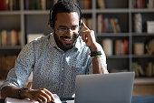 istock African man wear headset watching webinar video course 1253877182